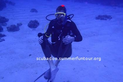 diver sitting on sand bed